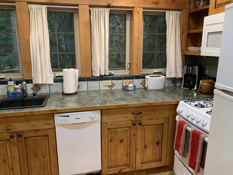 Full size frig, gas stove, dishwasher