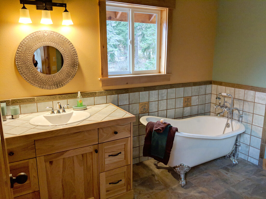 The second master bath has a claw foot soaking tub and shower.